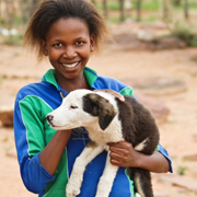 Afrikaans meisje met hond
